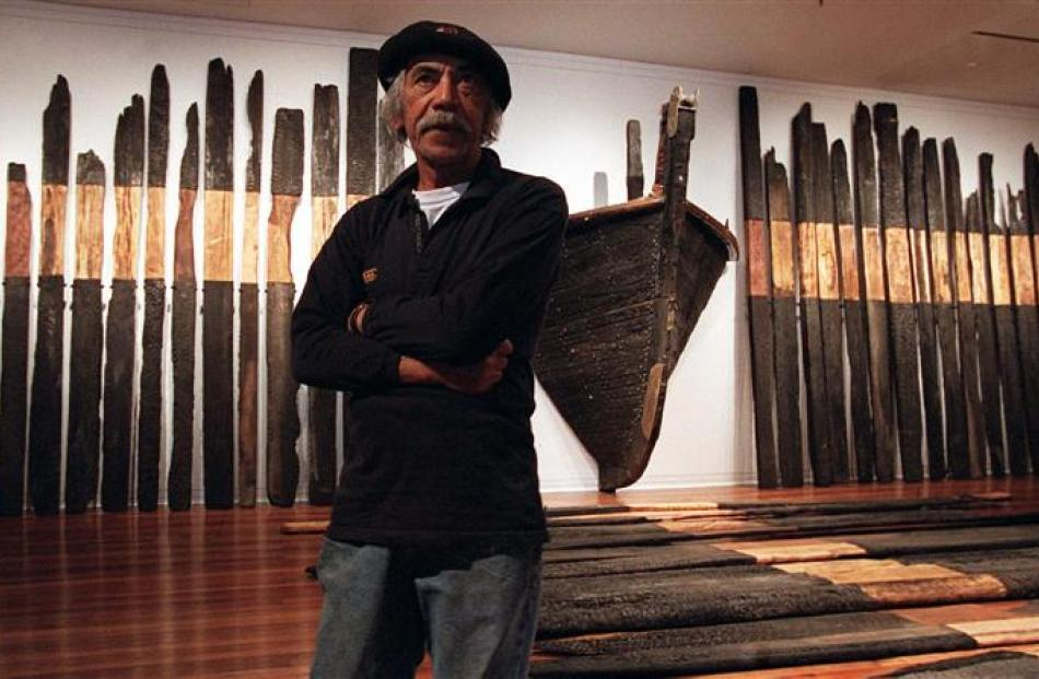 Ralph Hotere with his Black Phoenix installation at the Dunedin Public Art Gallery in 2000. Photo...