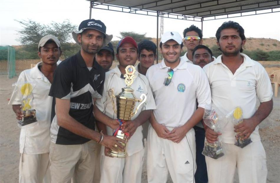 Captain Naresh Vasu with his New Zealand cricket team-mates.
