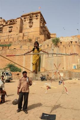 Slack wire walkers start young in the living fort of Jaisalmer.