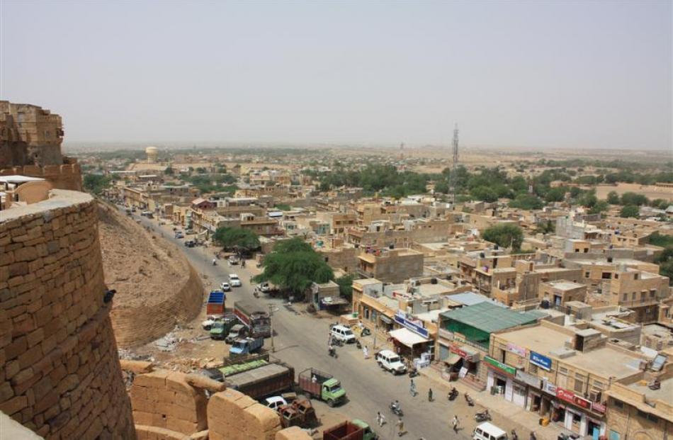 The desert town of Jaisalmer sprawls out below the Sonar Fort.