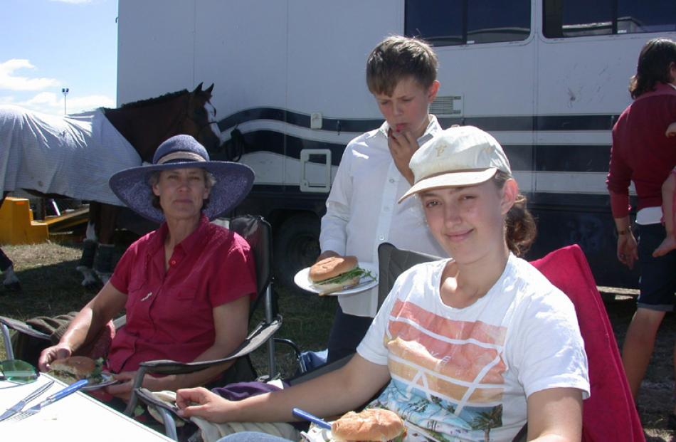 Amanda, Sebastian (10) and Beth Walker, of Ashburton, have lunch between horse competitions.