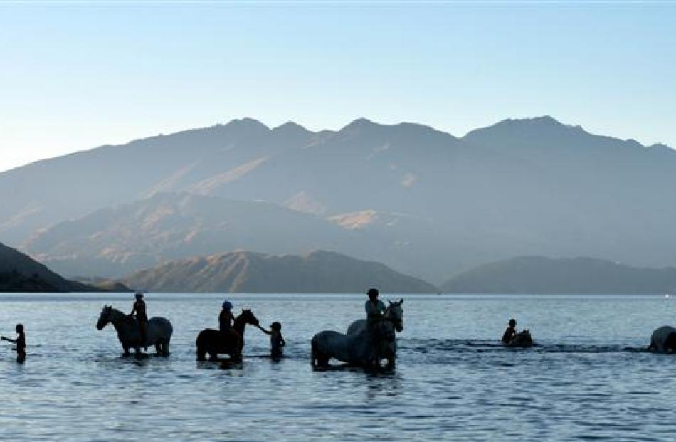 Children wallow in Lake Wanaka on their horses after the Upper Clutha A&P Show on Saturday...