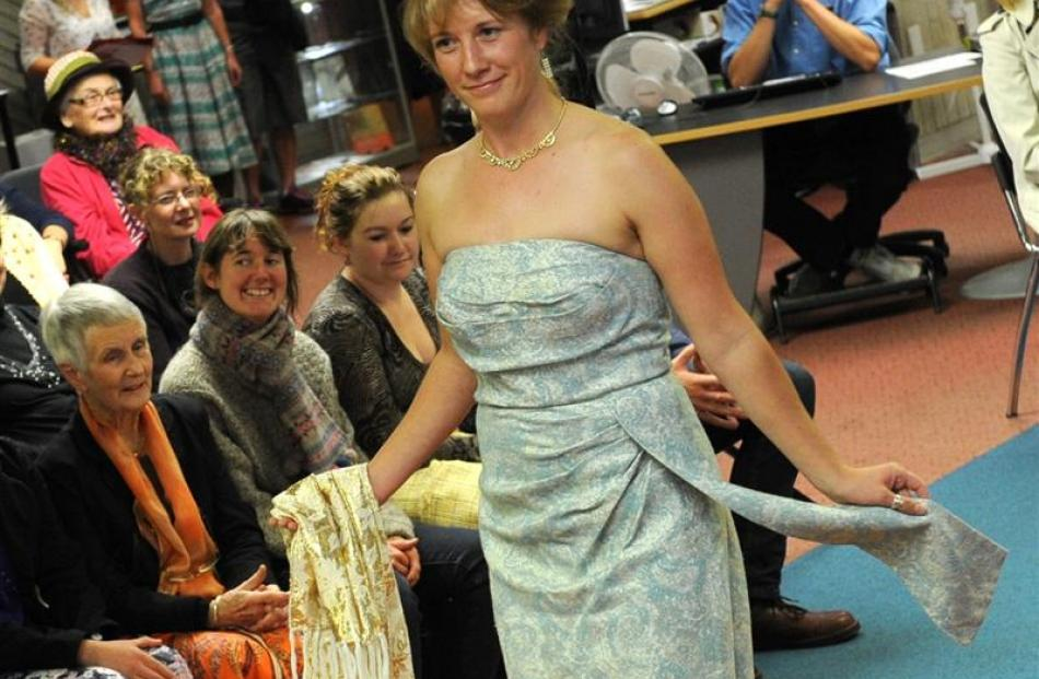 librarian Shana Clyne shows off her strapless gown.