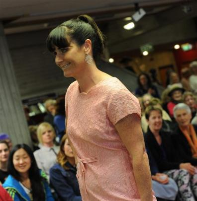 Melanie van de Klundert struts cheered on by family.
