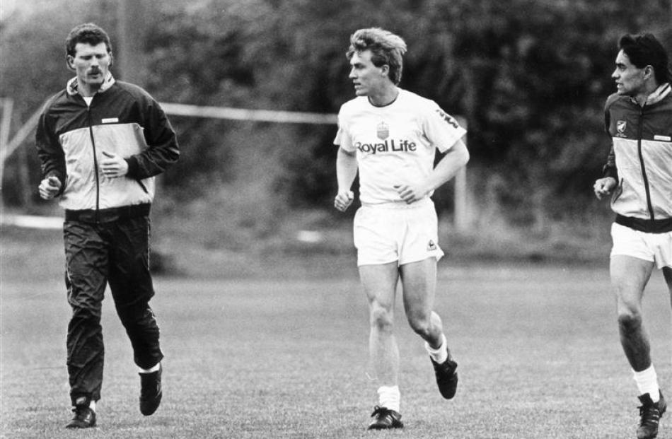 All Whites (from left) Ricki Herbert, Mike McGarry and Richard Mulligan head out for a jog at...