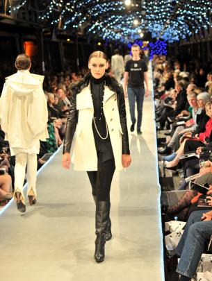 Leather sleeves and a black fur collar on  a classic winter coat from DEVa'L.