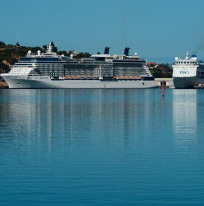 Celebrity Solstice and Pacific Pearl sit at berth in Port Chalmers yesterday  morning.