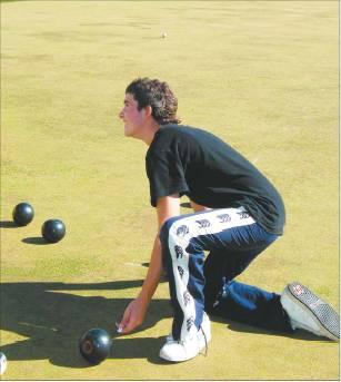 Made to measure: Liam Dowling (15), of Maniototo Area School, checks whose bowl is the closest.