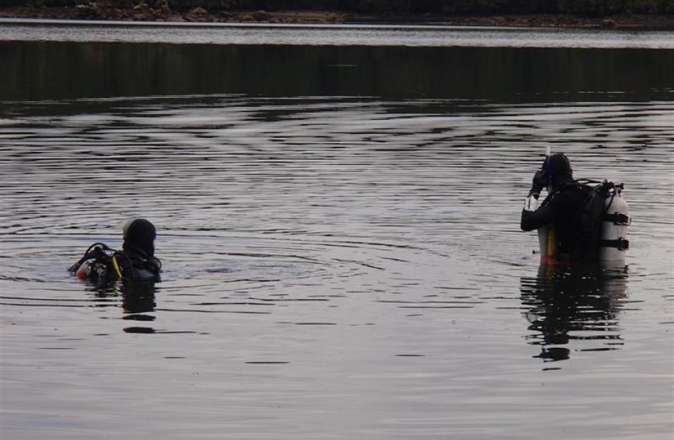 Divers prepare to search the seabed for debris from the Othello.