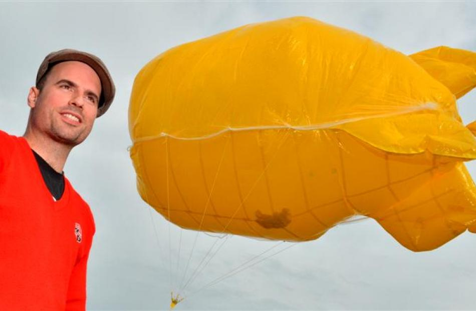 Artist Shane McGrath prepares the balloon in Wharf St, Dunedin, yesterday morning. Photos by...