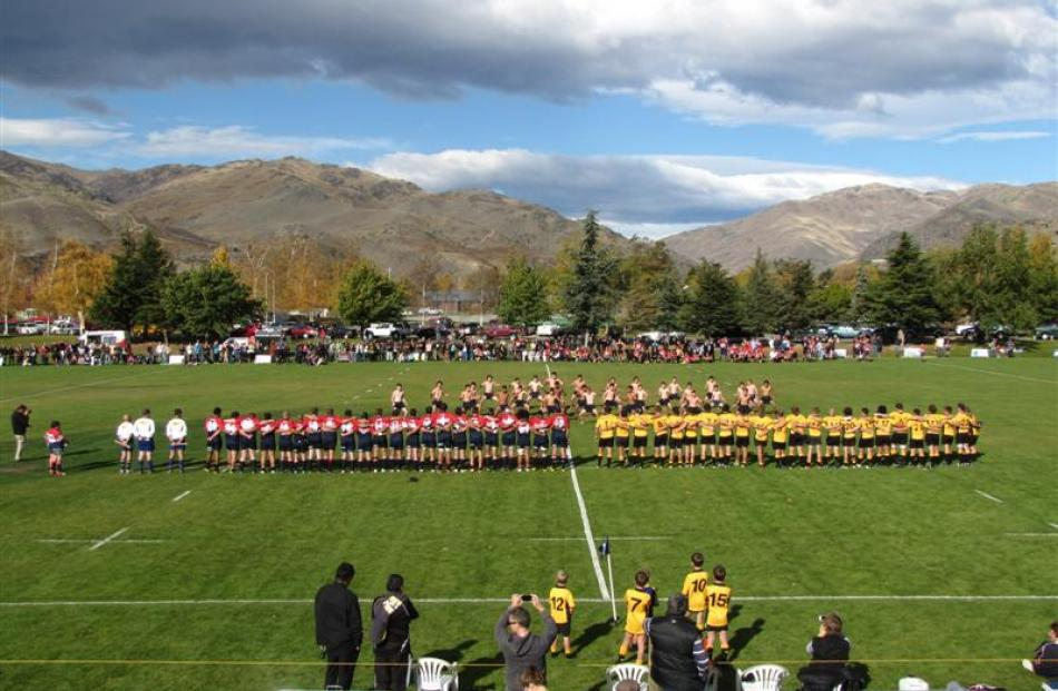 The Cromwell and Upper Clutha premier rugby teams face the  Cromwell College haka before  playing...