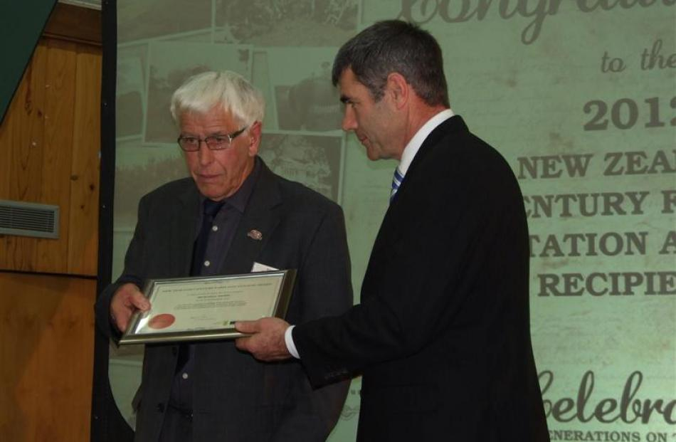 New Zealand Century Farm and Station Awards patron Russell Brown receives an award from Primary...