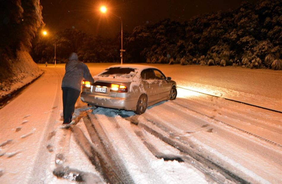 A passenger helps a motorist on Drivers Road do a U turn. Photo by Stephen Jaquiery