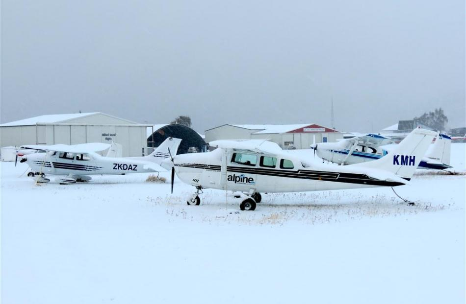 Sight-seeing and private planes covered in snow in Queenstown. Photo by James Beech