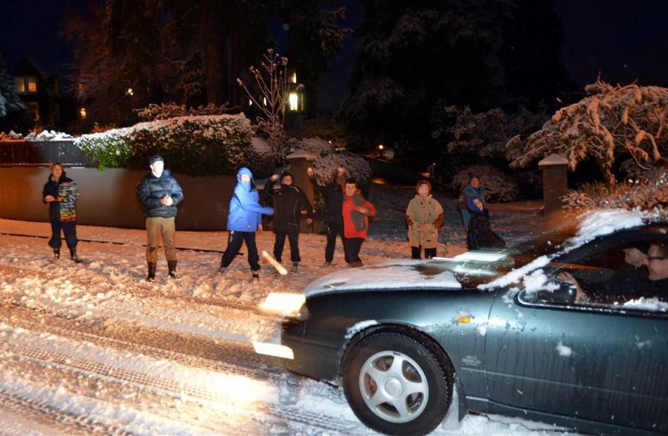 Take that . . . Boarders at OBHS giver motorists a snowy welcome as they negotiate Highgate....