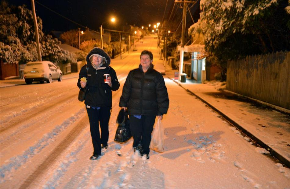 Where's these a will . . . Keryn Grice (left) and Linda Brown, both from mosgiel, walk along...