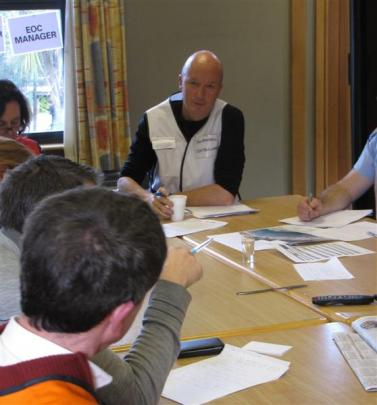 Queenstown Lakes District Council emergency management officer Jon Mitchell is briefed during the...