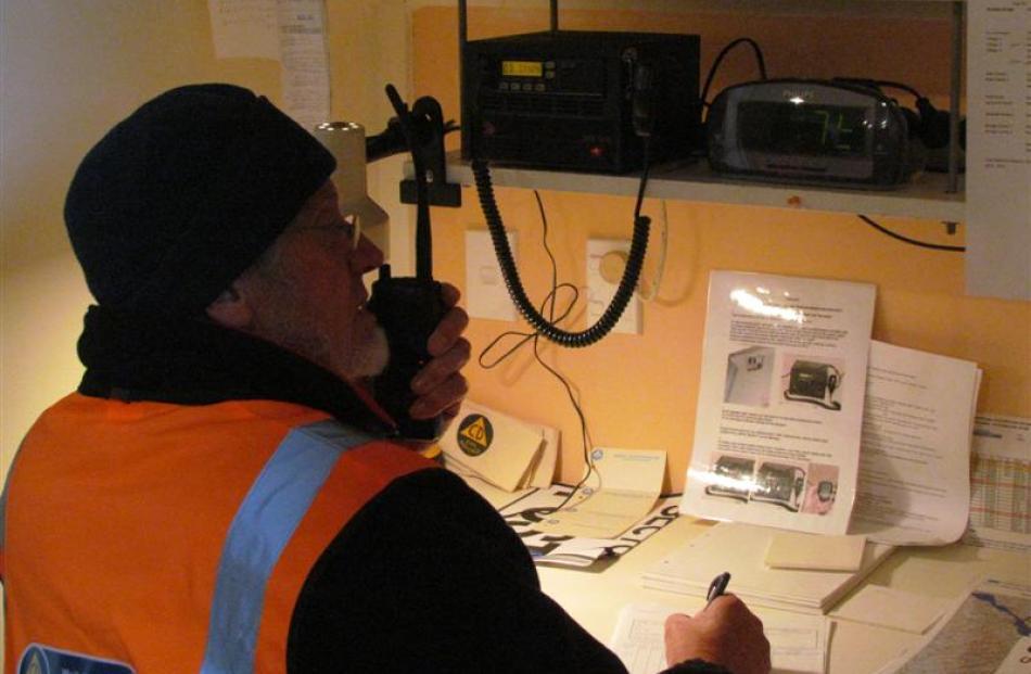 Waitaki Bridge Civil Defence volunteer John Thorn mans the radio during yesterday's South Island...