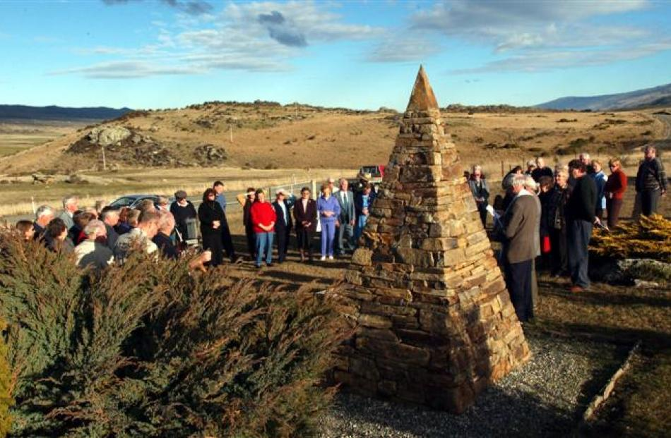 People gather at the memorial cairn on the occasion of the 60th anniversary. Photos from the ODT...