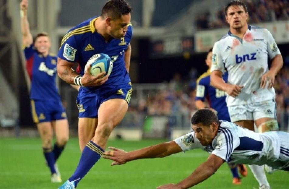 Hosea Gear skips away from Blues fullback Charles Piutau for a try at Forsyth Barr Stadium on...