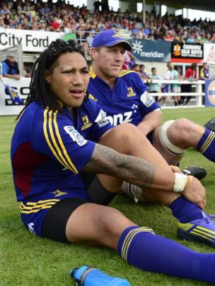 Ma'a Nonu (left) and Brad Thorn watch the pre-season match between the Highlanders and the...