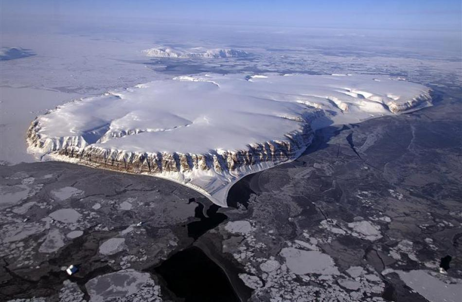 An image of Saunders Island and Wolstenholme Fjord taken for Operation IceBridge, a NASA survey...