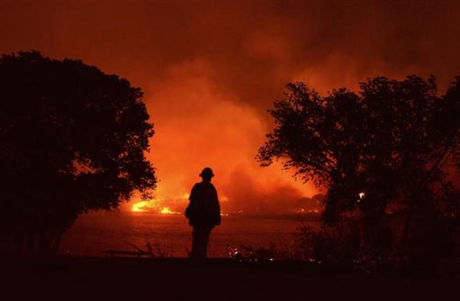 Firefighters battle wildfires in California this week.