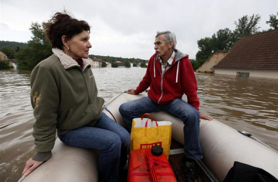 Residents observe their flooded village of Kresice near the city of Litomerice, in the Czech...