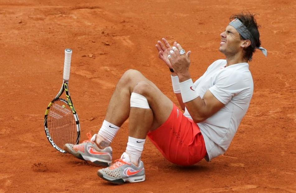 Rafael Nadal celebrates defeating to claim his eighth French Open title. REUTERS/Philippe Wojazer