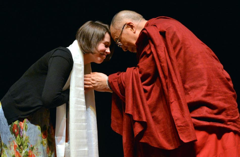 Dunedin City Councillor Jinty Mctavish farewells the Dalai Lama after his speech.