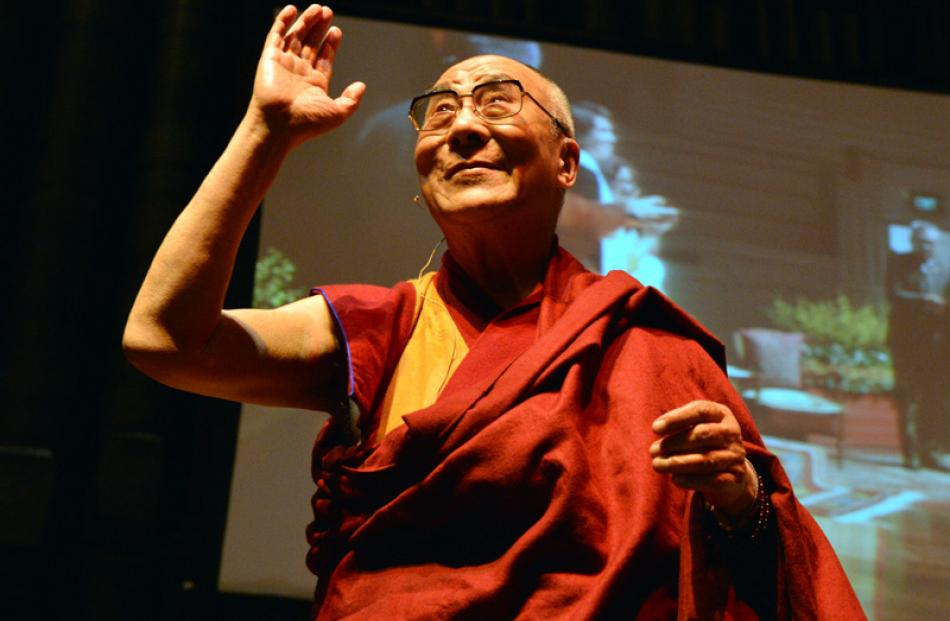 The Dalai Lama acknowledges a standing ovation.
