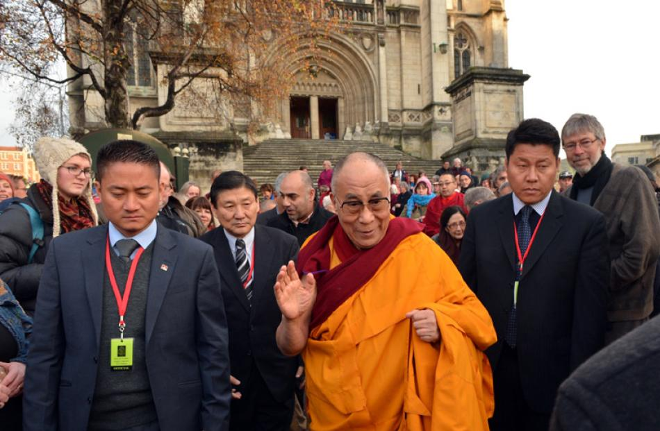 The Dalai Lama leaves the gathering of church representatives.