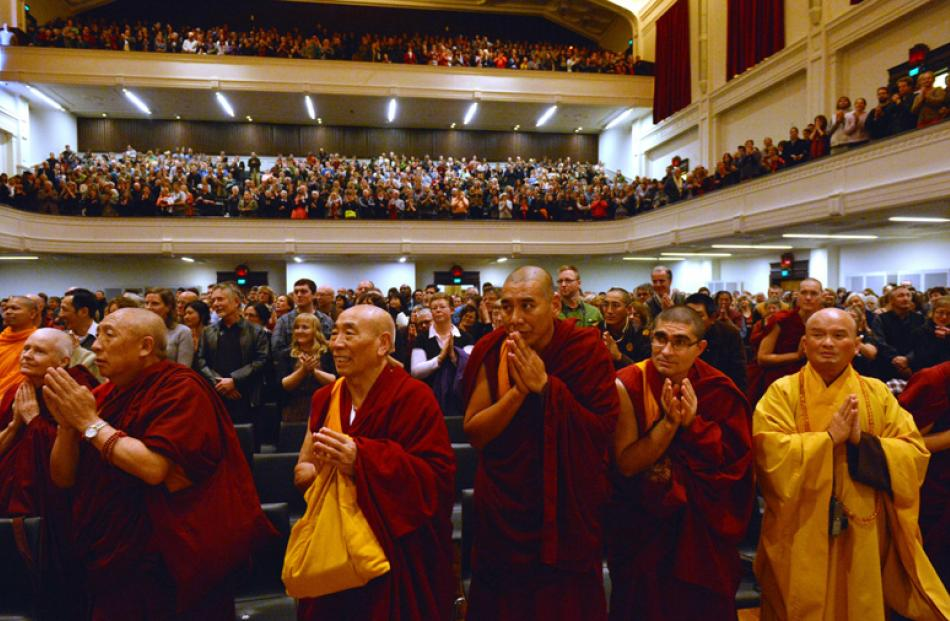 The Dalai Lama receives a standing ovation after his speech.