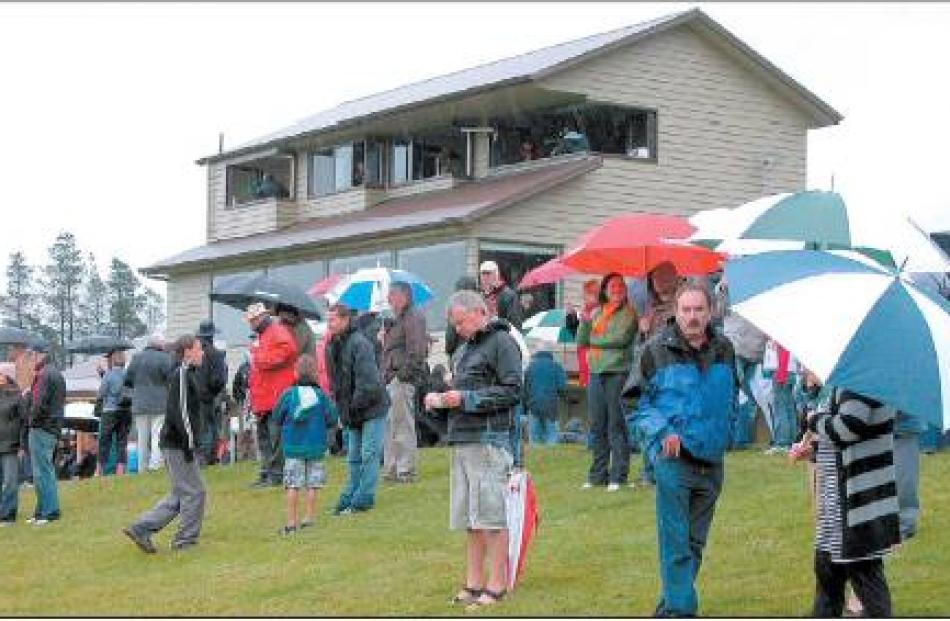 Well equipped: A sea of umbrellas greeted Cromwell's race-goers.