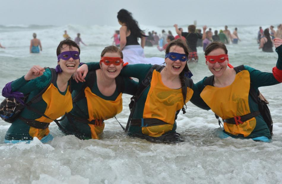 Dressed as Teenage Mutant Ninja Turtles yesterday  were (from left) Claire Black (23), of Dunedin...