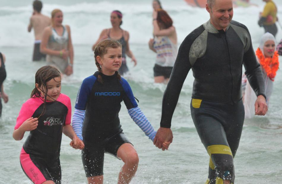Coming in from the Polar Plunge  yesterday are (from right) Conrad Anderson, Ruby Anderson (8)...