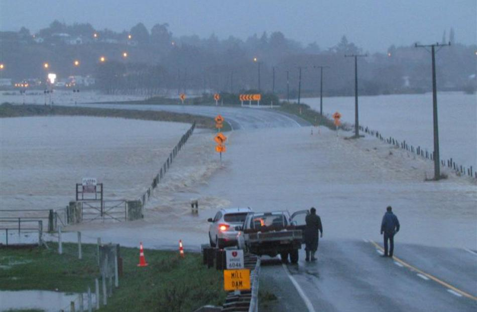 No way through...Floods close State Highway 1 at Mill Dam, just north of Maheno. Photo by Andrew...