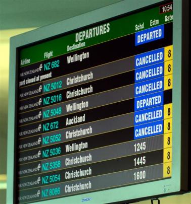 The departure board at the airport yesterday. Photos by Gerard O'Brien.