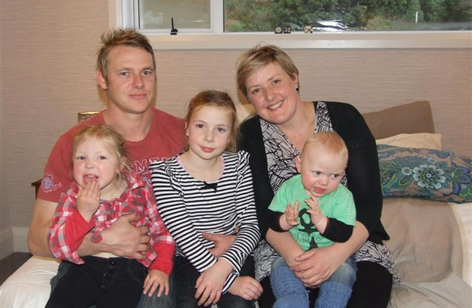 The Owen family (from left)  Meg (4), Terry, Charli (8), Jodie, and Baxter (7 months) relax in ...