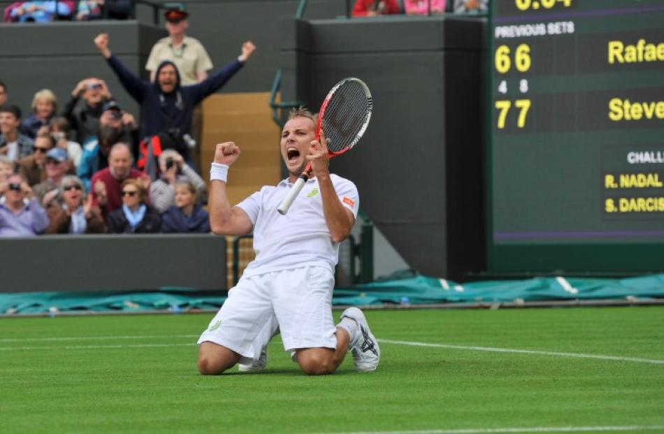 Darcis celebrates after defeating Nadal. REUTERS/Toby Melville