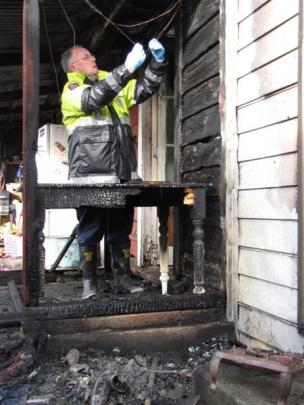 Mr Gibson investigates fires around the region. Photos from ODT Files.