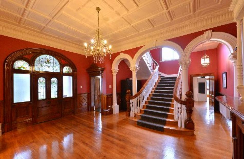 Venard's entrance hall, with its ornate archways and pressed tin ceiling, hints at the size and...