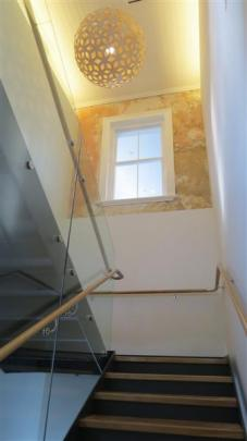 The new  staircase at the  H.D. Skinner Annexe passes beneath a section of wall which has been...