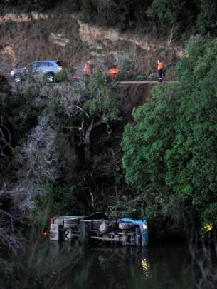 A Fulton Hogan truck lies in Otokia Creek  yesterday. Photos by Linda Robertson.