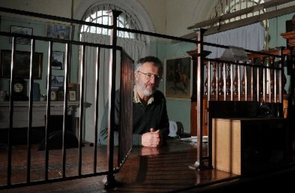 Bill Lang at the 6m-long counter made from rimu, kauri and totara and the grille which was...