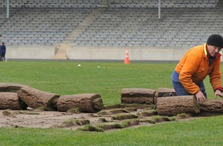 Carisbrook Rotary Project chairman Brendon Bearman rolls turf.