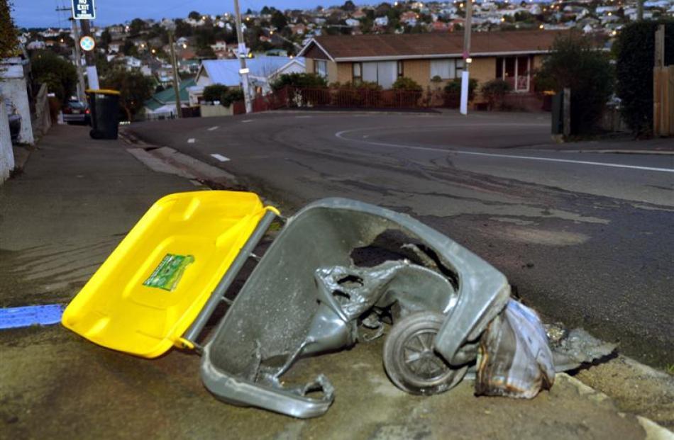 Wheelie-bins burnt in Dunedin yesterday: Haig St. Photos by Stephen Jaquiery.