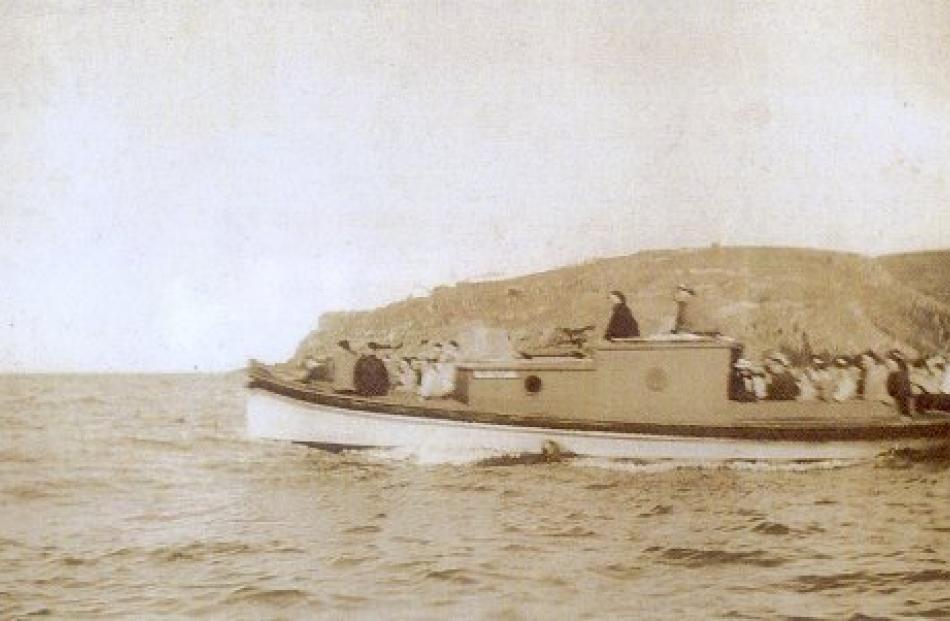 Elsie Evans passes Taiaroa Head in the mid-1940s.