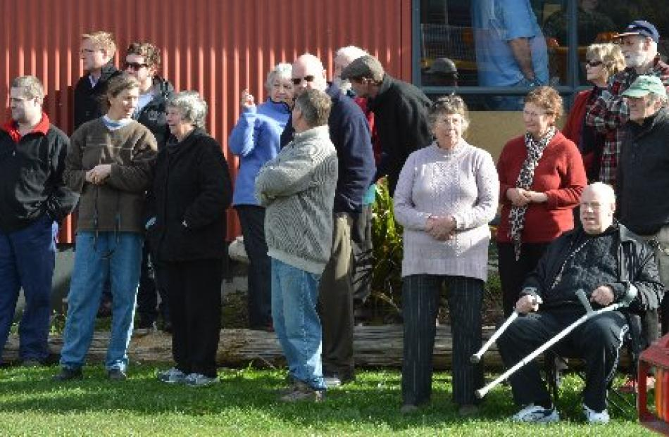 Onlookers watch the launch of the restored ferry yesterday.