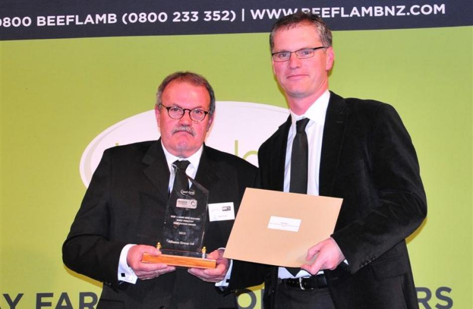 Alliance Group chairman Owen Poole (left) accepts the Beef and Lamb New Zealand sheep industry...